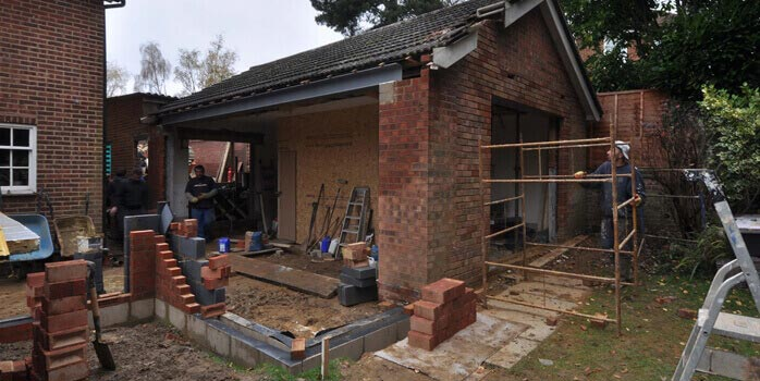 opening up of outbuilding to link to new extension