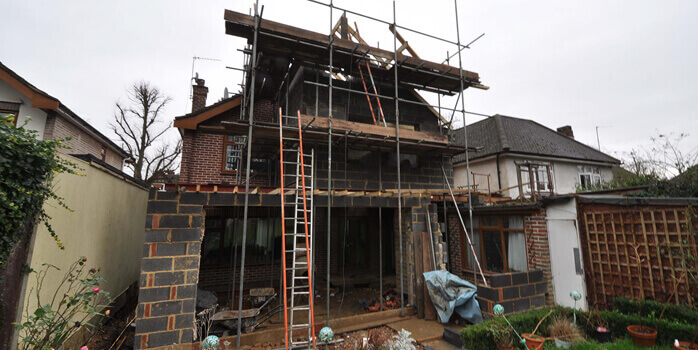 extension, scaffolding going up