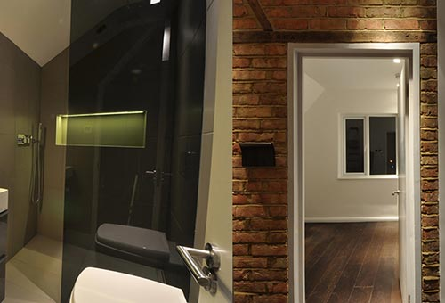 Bathroom and exposed brickwork as part of this loft conversion